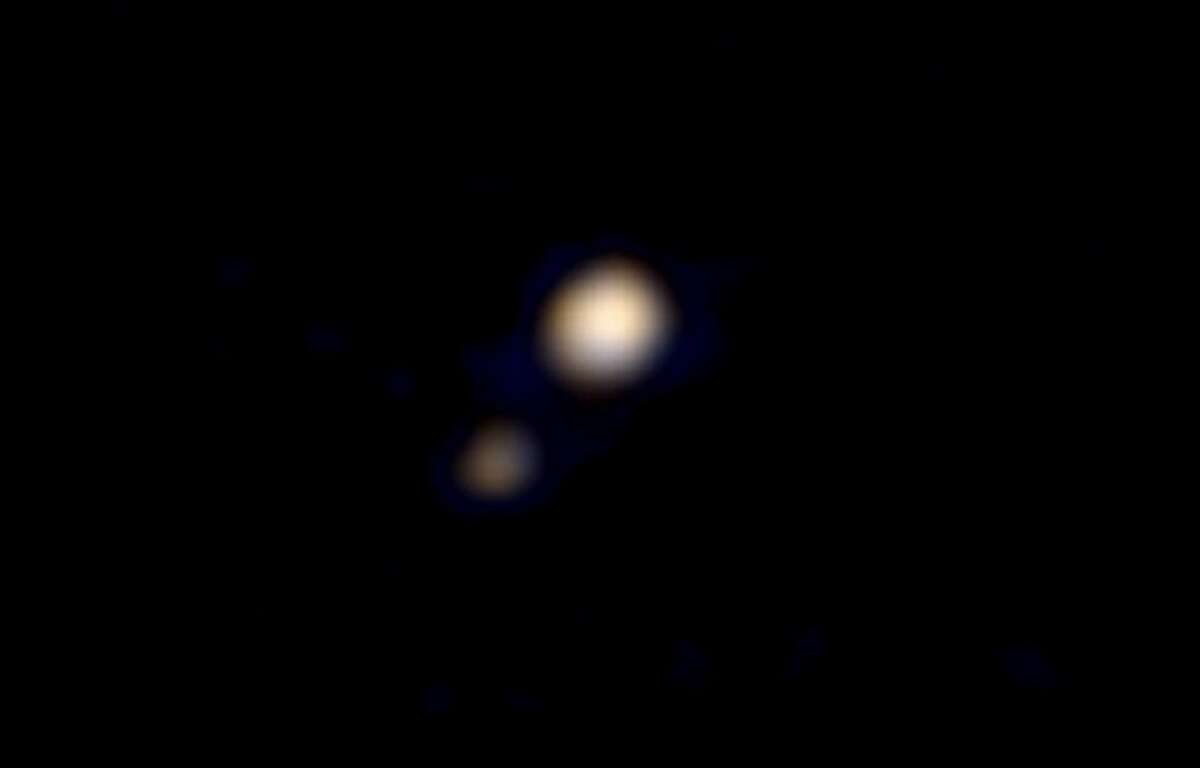 Pluto and Charon are seen in this first color image of the planet taken by the New Horizons spacecraft.