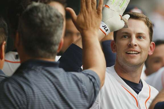 HOUSTON, TX - APRIL 15:  Jed Lowrie of the Houston Astros receives  congratulations from the dugout after hitting a home run in the first inning against the Oakland Athletics at Minute Maid Park on April 15, 2015 in Houston, Texas. All Major League Baseball players are wearing #42 today in honor of Jackie Robinson Day.  (Photo by Bob Levey/Getty Images)