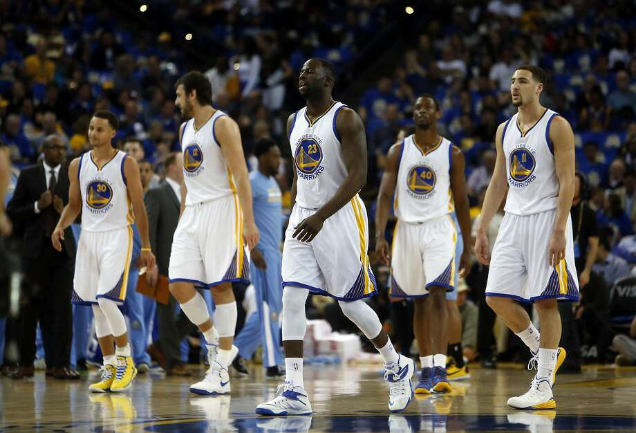 (left to right) Golden State Warriors' Stephen Curry, Andrew Bogut, Draymond Green, Harrison Barnes and Klay Thompson in 1st quarter against Denver Nuggets during NBA game at Oracle Arena in Oakland, Calif., on Wednesday, April 15, 2015. Photo: Scott Strazzante, The Chronicle