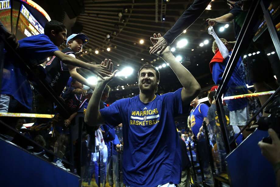Golden State Warriors' Andrew Bogut greets fans as he leaves the court after 133-126 win over Denver Nuggets in NBA game at Oracle Arena in Oakland, Calif., on Wednesday, April 15, 2015. Photo: Scott Strazzante, The Chronicle