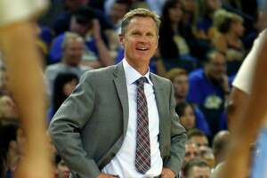 Golden State Warriors' head coach Steve Kerr enjoys 4th quarter of 133-126 win over Denver Nuggets in NBA game at Oracle Arena in Oakland, Calif., on Wednesday, April 15, 2015.