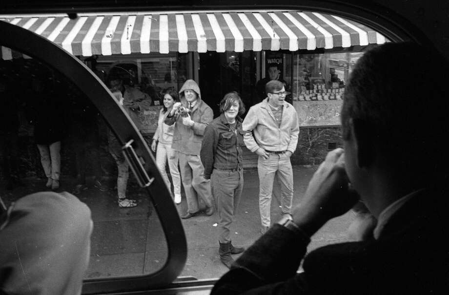 """April 26, 1967: A Gray Lines bus takes a """"Hippie Tour"""" through the Haight-Ashbury District in San Francisco. Photo: Art Frisch, The Chronicle"""