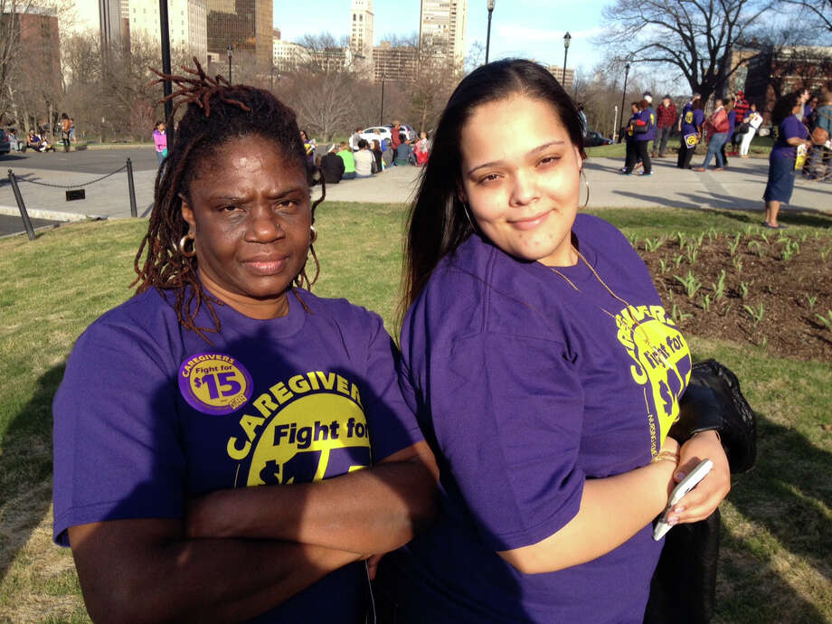 Tensie Edwards, left and Cherise Rivera, both of Bridgeport, were among 1,000 low-wage workers who attened a rally for higher wages held at the Capitol in Hartford, Conn., Wednesday, April 15, 2015. Photo: Ken Dixon / Connecticut Post