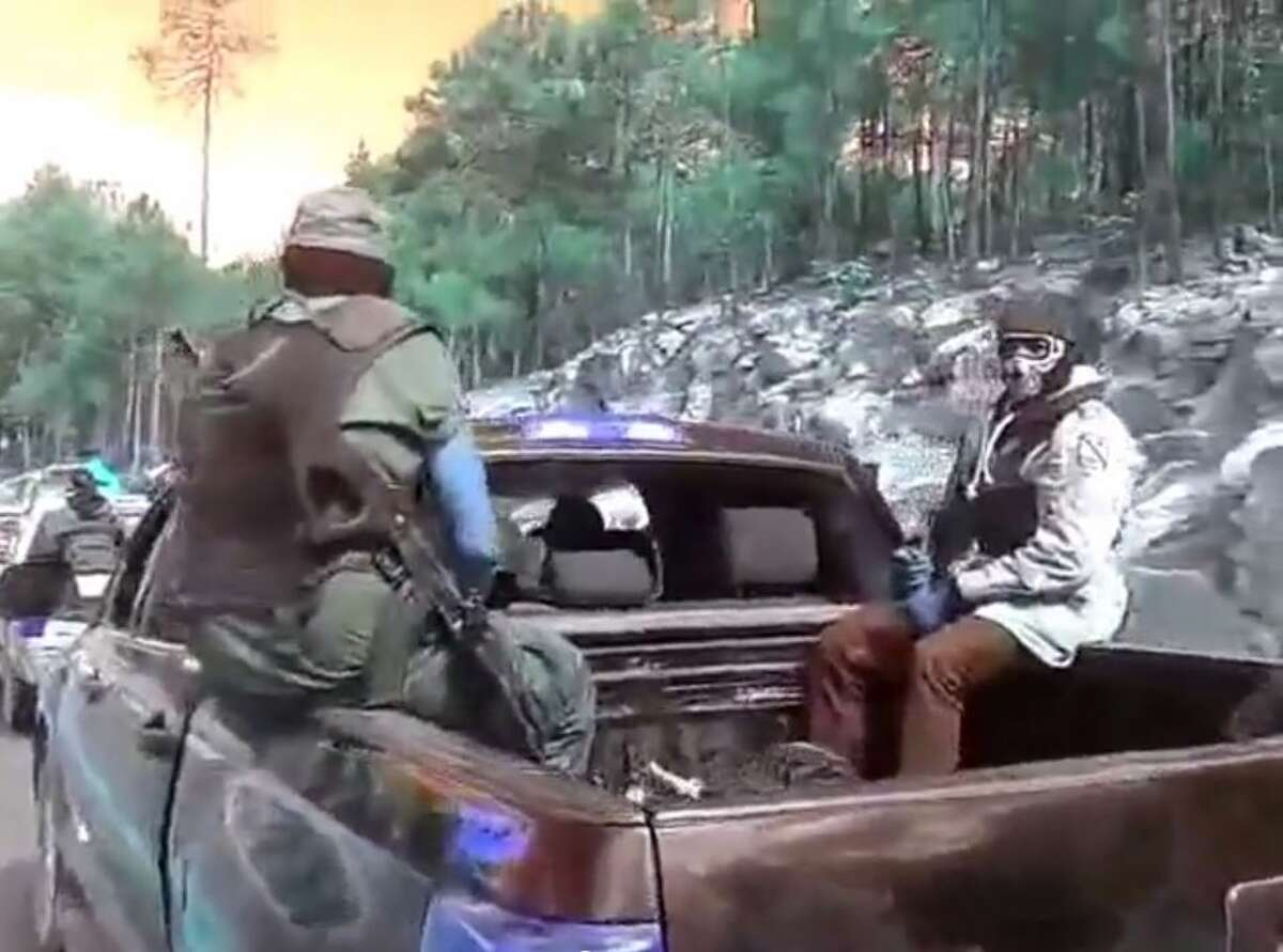 A video posted to YouTube on April 8, 2015, by online tabloid La Polaka shows several masked men with assault rifles sitting in and standing around pickup trucks stopped on a mountain road in Southwestern Chihuahua. The Chihuahua state attorney general's office told the El Paso Times that the footage was filmed before a September battle between two rival groups near the town of Tonachí, where Mexican authorities found 11 men dead and four torched vehicles.