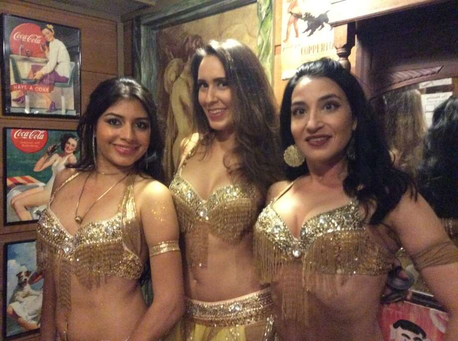 The BellaDonna belly dancers get ready to perform for the crowd at Agora, 1712 Westheimer, on Wednesday, April 15, 2015. Photo: Andrea Waguespack/Houston Chronicle