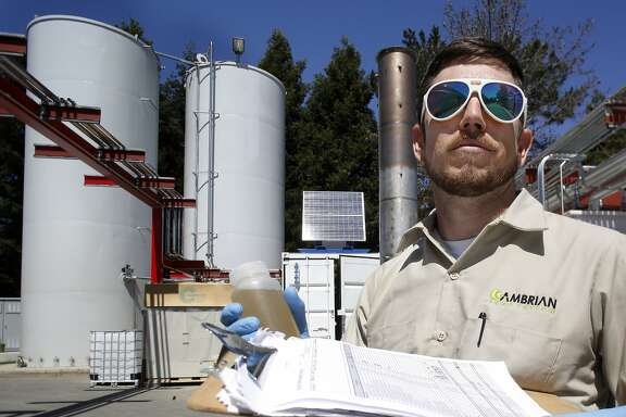 Cambrian systems operator Andrew Goodman tests waste water samples from the new system that will clean up the waste water from the Lagunitas Brewing Company brewing process  and generate electricity in Petaluma, California, on Tuesday, April 14, 2015.