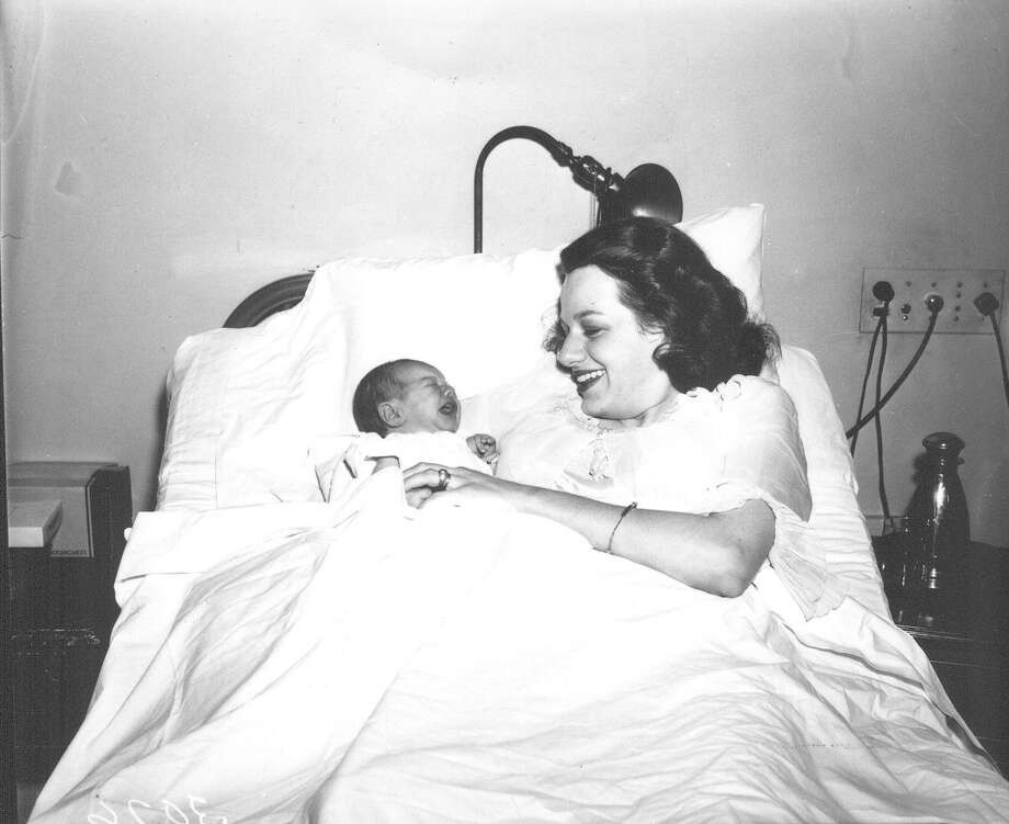 Mrs. Samuel B. Knowles and infant son, Sam, at the Nix Hospital. Photo published in San Antonio Light, July 27, 1943. Sam's father, Lt.Col. Samuel B. Knowles Jr., received news of his son's birth on the same day he shot down his first Japanese plane. Photo: UTSA Special Collections / San Antonio Light Collection