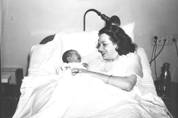 Mrs. Samuel B. Knowles and infant son, Sam, at the Nix Hospital. Photo published in San Antonio Light, July 27, 1943. Sam's father, Lt.Col. Samuel B. Knowles Jr., received news of his son's birth on the same day he shot down his first Japanese plane.