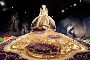 """The dress worn by Peggy Pitman in 1959 as the Queen of the Court of Courts can be seen in the Witte Museum's exhibit """"Jewels of the Court: A Journey Through Fiesta?•s Coronation"""" where 28 Fiesta robes are on display including one for every decade since the Order of the Alamo participated in the the parades in 1909. The exhibit runs until May 3."""