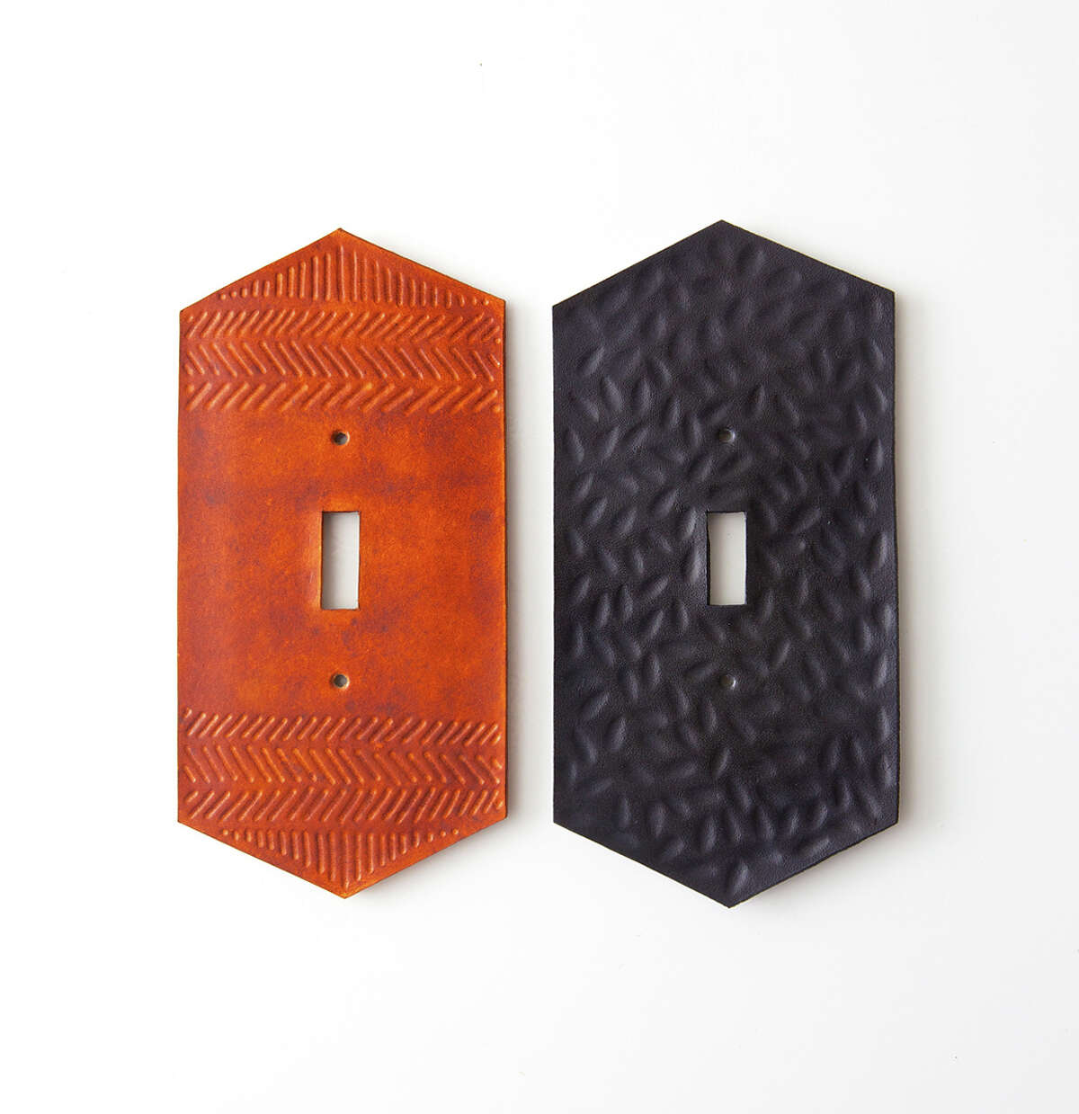 Hand-tooled leather lightswitch plates from Canoe in Austin will be featured at the Lawndale Art Center's Design Fair 2015.