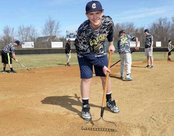 Cohoes High JV baseball's Danny Buchanan, 14, works with team mates during the '4 in 24' Youth Field Renovation Project work at Berkley Park Thursday April 16, 2015, in Cohoes, NY.  Buchanan proposed the field as as part of the challenger program. (John Carl D'Annibale / Times Union) Photo: John Carl D'Annibale / 00031436A