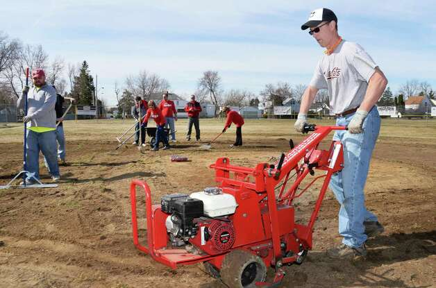 Rick Murphy, Vice President / General Manager, Tri-City ValleyCats works along side other volunteers for the '4 in 24' Youth Field Renovation Project work at Berkley Park Thursday April 16, 2015, in Cohoes, NY.  (John Carl D'Annibale / Times Union) Photo: John Carl D'Annibale / 00031436A
