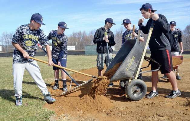 Members of the Cohoes High JV baseball team work during the '4 in 24' Youth Field Renovation Project work at Berkley Park Thursday April 16, 2015, in Cohoes, NY.  (John Carl D'Annibale / Times Union) Photo: John Carl D'Annibale / 00031436A
