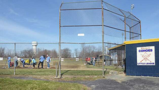 Volunteers work during the '4 in 24' Youth Field Renovation Project work at Cohoes Little League's Berkley Park Thursday April 16, 2015, in Cohoes, NY.  (John Carl D'Annibale / Times Union) Photo: John Carl D'Annibale / 00031436A