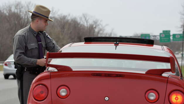 Trooper Emmett Kinzel stops a vehicle for excessive speed as he participates in a week-long enforcement initiative targeting speeding and aggressive drivers across the state Friday afternoon April 18, 2014 on I-87 in Latham, N.Y.  (Skip Dickstein / Times Union archive) Photo: Skip Dickstein / 00026558A