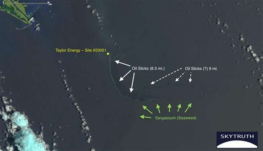 This June 21, 2014 satellite photo from NASA, annotated by SkyTruth, shows an oil slick extending in an arc at least 8.3 miles long from a well site at a Taylor Energy Company platform which was toppled in an underwater mudslide triggered by Hurricane Ivan's waves in September 2004. The white cotton-like formations are clouds, and the mouth of the Mississippi River is visible in the green land mass at the upper left. (NASA/SkyTruth via AP)