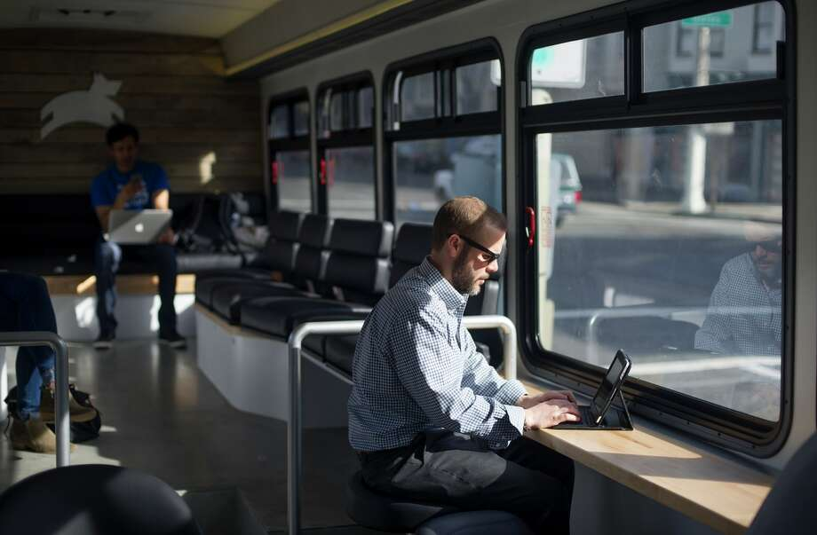 David Dow works from on his iPad as he rides one of Leap's luxury buses. Photo: JOSH EDELSON / AFP / Getty Images / Josh Edelson / AFP
