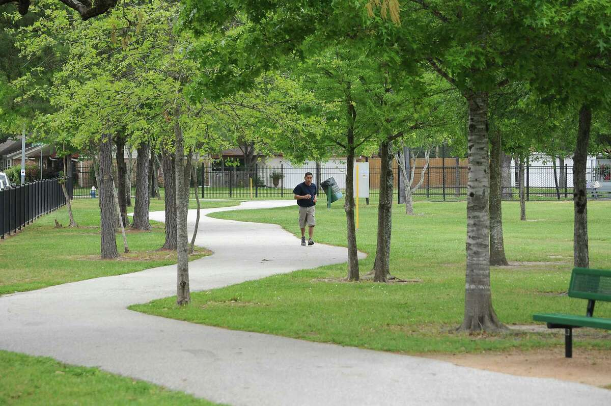 A jogger does a lap around the track at Nob Hill Park near Chelsea McCorvey's Spring Branch home Monday April 06, 2015.(Dave Rossman photo)