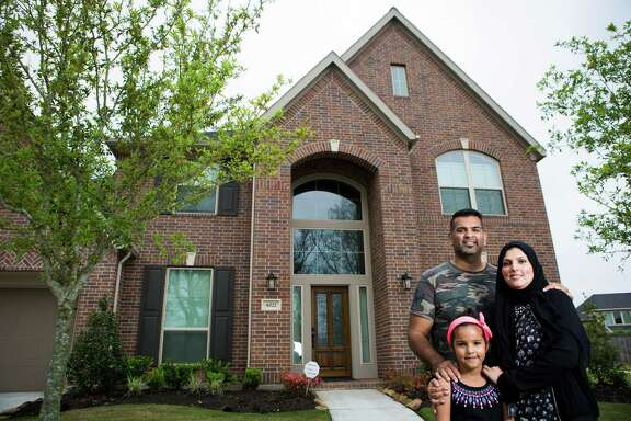 Chad Ahmad and his wife Kiran Ahmad and his six-year-old daughter stand in front of their home in Sugar Land. The family moved from Canada to Sugar Land last year in search for a town that could provide good schools and affordable comfortable home. Friday, April 3, 2015, in Sugar Land.
