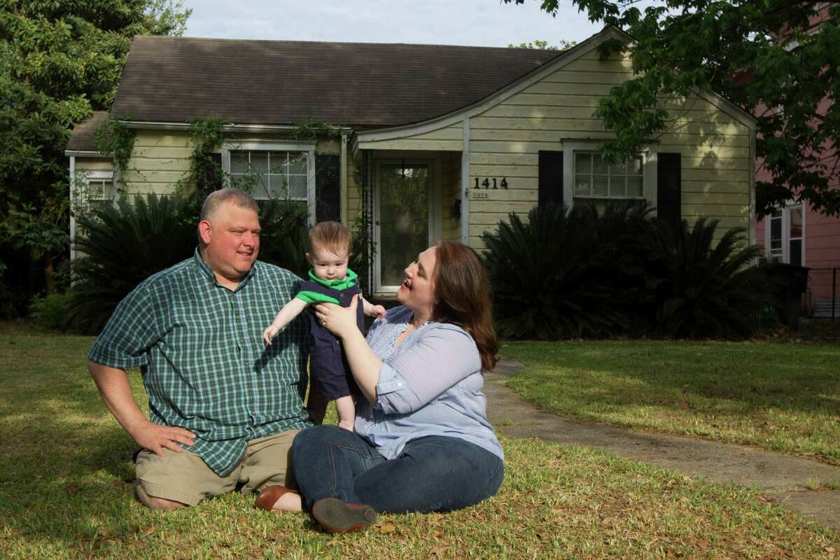 Laurie and Jerry Ramirez and their eight month old son Theodore pose for a portrait outside their home in the Heights on Saturday, April 4, 2015, in Houston. They have decided it was time to start searching for a home in the suburbs, but have had difficulty finding an affordable place.