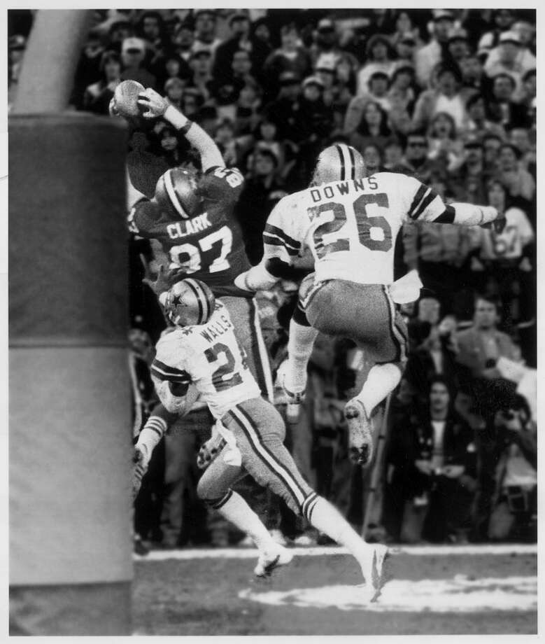 "NFC, 1981: 49ERS 28, COWBOYS 27This game launched one dynasty and derailed another. ""The Catch"" by Dwight Clark in the final minute gave the 49ers the lead and a critical tackle by Eric Wright kept Drew Pearson from breaking loose for the winning touchdown on Dallas' final drive. The Cowboys then fumbled, with the 49ers recovering to clinch their first Super Bowl trip. Photo: Frederic Larson, SF Chronicle"