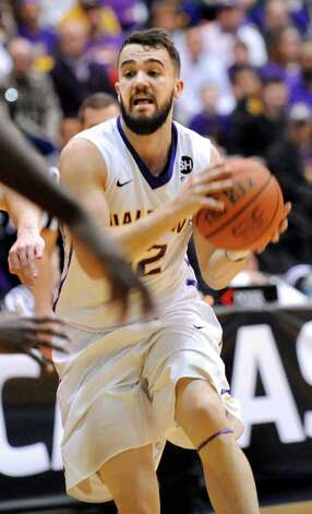 UAlbany's Peter Hooley, center, controls the ball during their America East Championship game against Stony Brook on Saturday, March 13, 2015, at UAlbany in Albany, N.Y. (Cindy Schultz / Times Union) Photo: Cindy Schultz / 00030954A