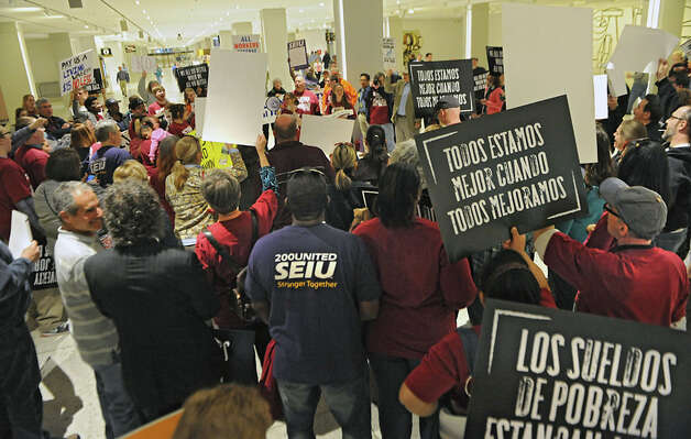 Fast food workers and others rally in support of a $15 per hour minimum wage at the Empire State Plaza on Wednesday, April 15, 2015 in Albany, N.Y. (Lori Van Buren / Times Union) Photo: Lori Van Buren, Albany Times Union / 00031444A