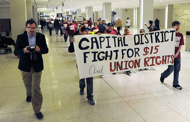 Fast food workers and others march across the concourse in support of a $15 per hour minimum wage at the Empire State Plaza on Wednesday, April 15, 2015 in Albany, N.Y. (Lori Van Buren / Times Union) Photo: Lori Van Buren, Albany Times Union / 00031444A
