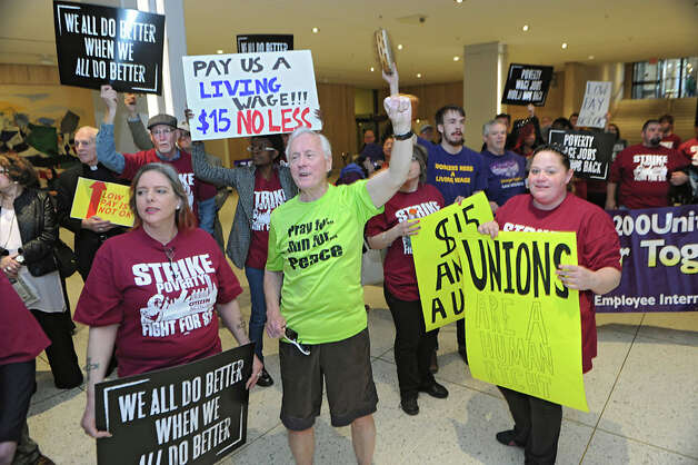 Fast food workers and others gather to march across the concourse in support of a $15 per hour minimum wage at the Empire State Plaza on Wednesday, April 15, 2015 in Albany, N.Y. (Lori Van Buren / Times Union) Photo: Lori Van Buren, Albany Times Union / 00031444A