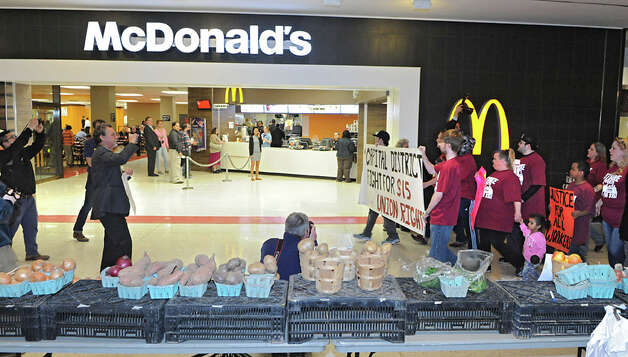 Fast food workers and others march across the concourse to McDonald's in support of a $15 per hour minimum wage at the Empire State Plaza on Wednesday, April 15, 2015 in Albany, N.Y. (Lori Van Buren / Times Union) Photo: Lori Van Buren, Albany Times Union / 00031444A