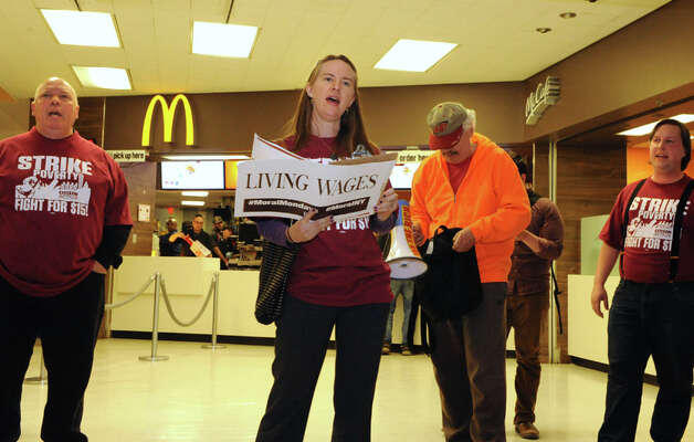 Volunteer Joanna Nadeau of FOCUS church speaks after fast food workers and others marched across the concourse to stand in front of McDonald's in support of a $15 per hour minimum wage at the Empire State Plaza on Wednesday, April 15, 2015 in Albany, N.Y. (Lori Van Buren / Times Union) Photo: Lori Van Buren, Albany Times Union / 00031444A