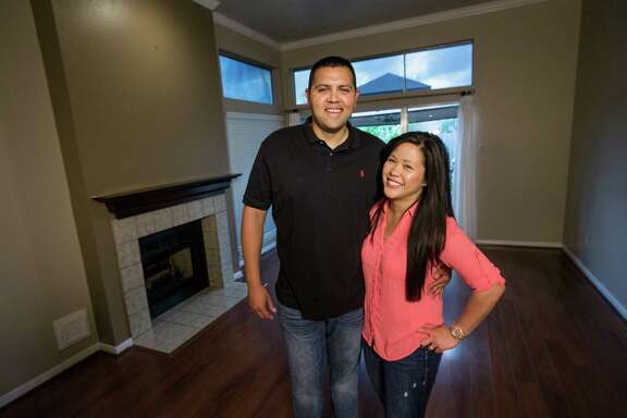 Rudy and Cindy Amador pose for a portrait in their new home on Wednesday, April 1, 2015, in Clear Lake.