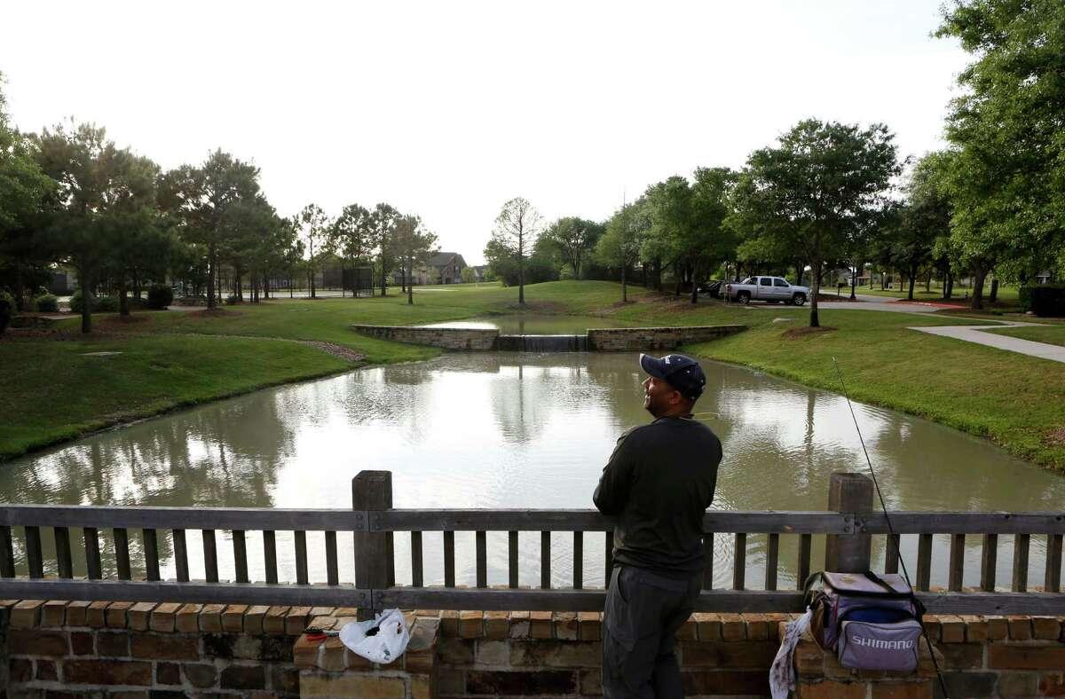 Garth Lee enjoys fishing in the Bridgeland community Saturday, April 4, 2015, in Houston.