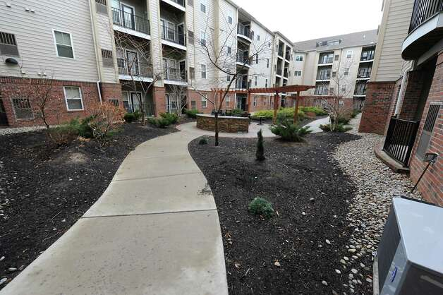 Courtyard where residents can use a gas grill and fire pit at The Alexander at Patroon Creek on Friday, April 10, 2015 in Albany, N.Y. (Lori Van Buren / Times Union) Photo: Lori Van Buren / 00031373A
