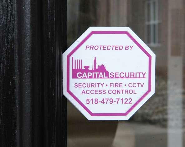 A security sticker is seen in the door of The Alexander at Patroon Creek on Friday, April 10, 2015 in Albany, N.Y. (Lori Van Buren / Times Union) Photo: Lori Van Buren / 00031373A