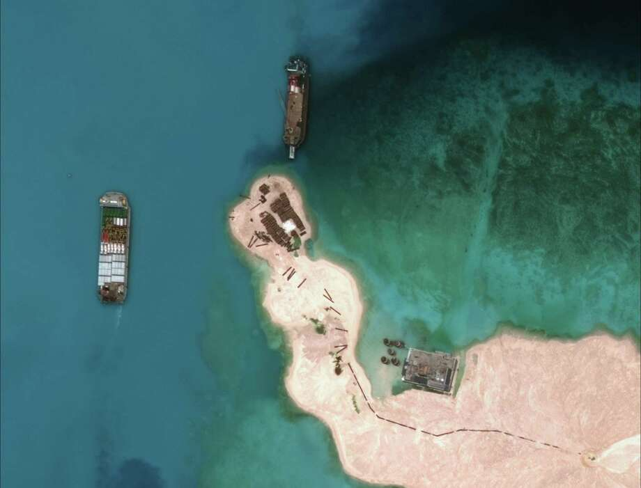 A satellite image shows Chinese vessels purportedly dredging sand at the disputed Mischief Reef. Photo: DIGITALGLOBE / AFP / Getty Images / AFP