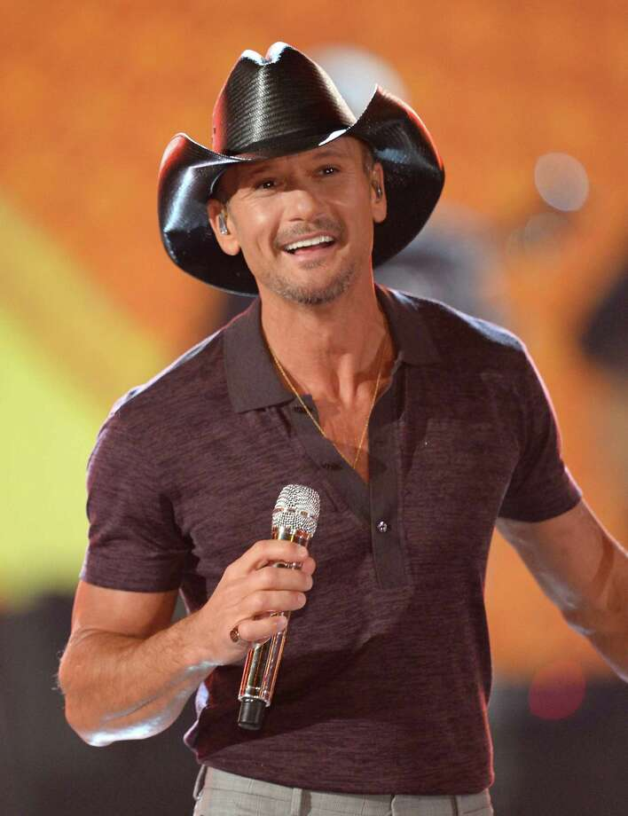 Musician Tim McGraw performs onstage during ACM Presents: An All-Star Salute To The Troops at the MGM Grand Garden Arena on April 7, 2014 in Las Vegas, Nevada. Photo: Ethan Miller, Getty Images For ACM / 2014 Getty Images