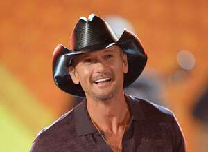 Musician Tim McGraw performs onstage during ACM Presents: An All-Star Salute To The Troops at the MGM Grand Garden Arena on April 7, 2014 in Las Vegas, Nevada.