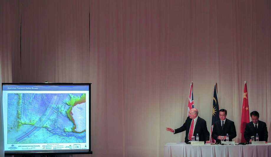 Australia's Deputy Prime Minister Warren Truss (left), shows an underwater search area planning map as Malaysia's Transport Minister Liow Tiong Lai and Chinese Transport Minister Yang Chuantan listen during the MH370 joint press conference at a hotel in Kuala Lumpur, Malaysia. The search zone for missing Malaysia Airlines flight MH370 will be doubled if nothing is found in the huge undersea area now being scanned for wreckage, government officials from Malaysia, Australia and China said. Photo: MOHD RASFAN / AFP / Getty Images / AFP