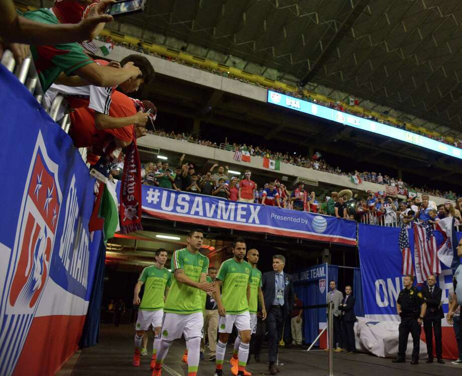 The Mexico national soccer team enters the Alamodome before the international friendly match against USA at the Alamodome on Wednesday, April 15, 2015. Photo: Billy Calzada, Staff / San Antonio Express-News / San Antonio Express-News