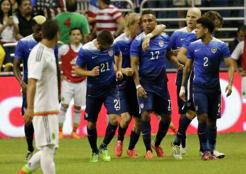 U.S. players congratulate teammate Juan Agudelo (17) after scoring the second goal against Mexico during the international friendly soccer match at the Alamodome on Wednesday, Apr. 15, 2015. The U.S. team defeated Mexico, 2-0. (Kin Man Hui/San Antonio Express-News) Photo: Kin Man Hui, Staff / San Antonio Express-News / ©2015 San Antonio Express-News