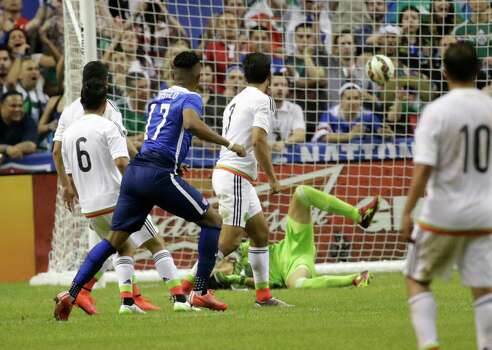 United States' Juan Agudelo (17) tracks his shot as it passes Mexico's goalkeeper Cirilo Saucedo (12) for the United State's second score during the international friendly soccer match at the Alamodome on Wednesday, Apr. 15, 2015. The U.S. team defeated Mexico, 2-0. (Kin Man Hui/San Antonio Express-News) Photo: Kin Man Hui, Staff / San Antonio Express-News / ©2015 San Antonio Express-News