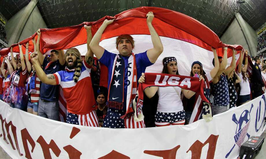 Fans celebrate in the closing moments as the United States team defeats Mexico during the international friendly soccer match at the Alamodome on Wednesday, Apr. 15, 2015. The U.S. team defeated Mexico, 2-0. Photo: Kin Man Hui /San Antonio Express-News / ©2015 San Antonio Express-News
