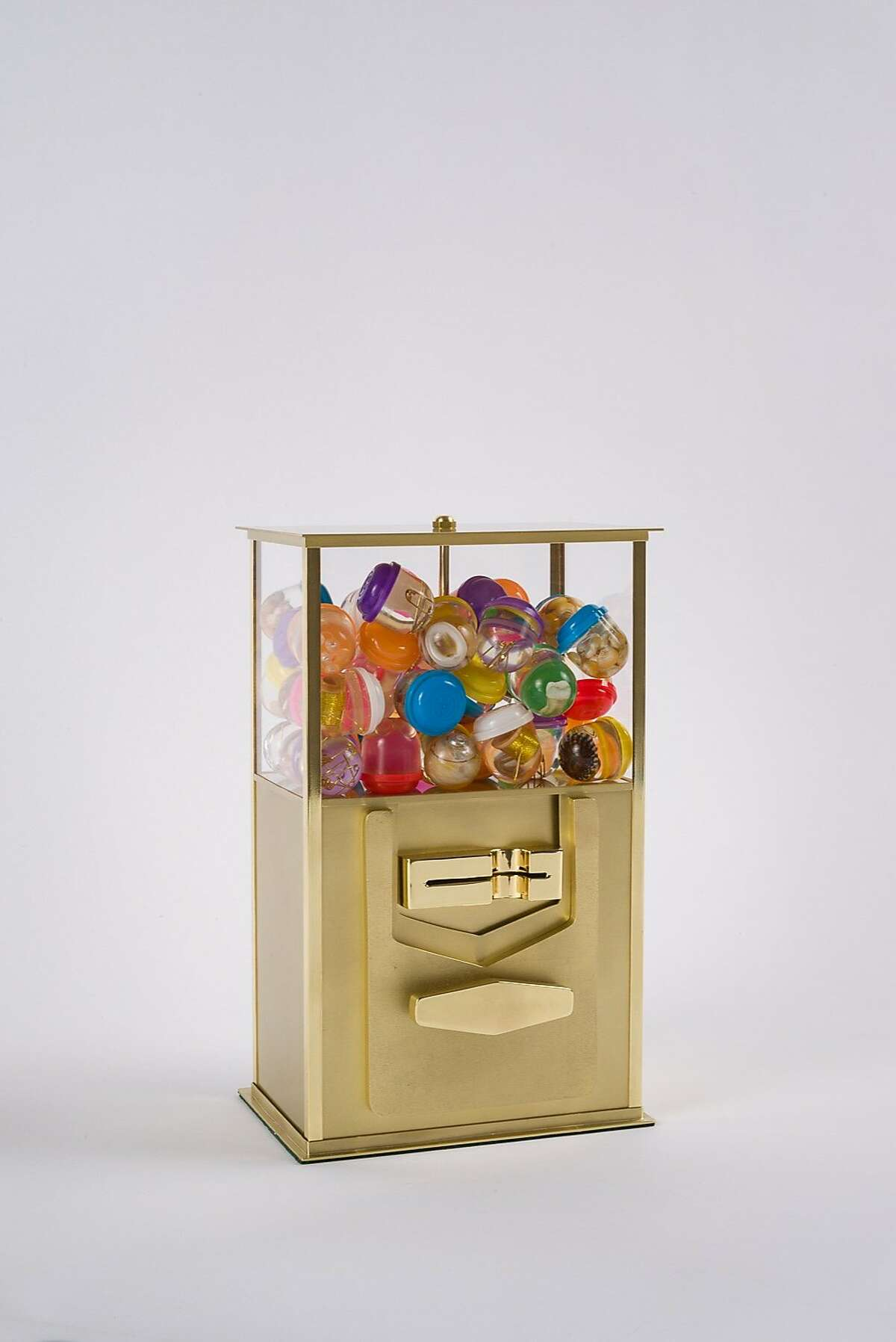 Yvonne Escalante, Your Turn, 2015. Brass, resin, acrylic sheet, felt, and found objects, 10 3/4 x 6 1/2 x 5 1/2 in. Photo by Johnna Arnold. The 2015 Dorothy Saxe Invitational: Tzedakah Box. On view April 9-May 17, 2015. The Contemporary Jewish Museum, San Francisco.