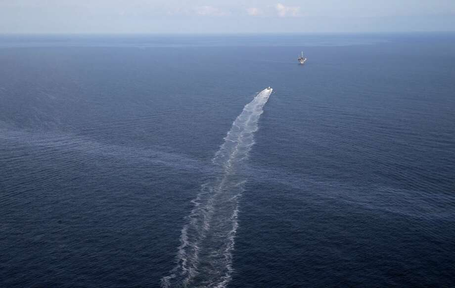 The wake of a supply vessel crosses an oil sheen coming from the old Taylor Energy oil rig. Photo: Gerald Herbert / Associated Press / AP