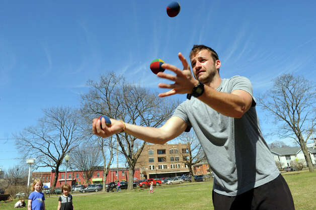 Adam Esposito of Saratoga Springs practices his juggling under a blue sky in Congress Park on Thursday April 16, 2015 in Saratoga Springs, N.Y. (Michael P. Farrell/Times Union) Photo: Michael P. Farrell