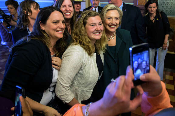 Hillary Rodham Clinton poses for a photo after meeting with Democratic lawmakers Wednesday in Des Moines.