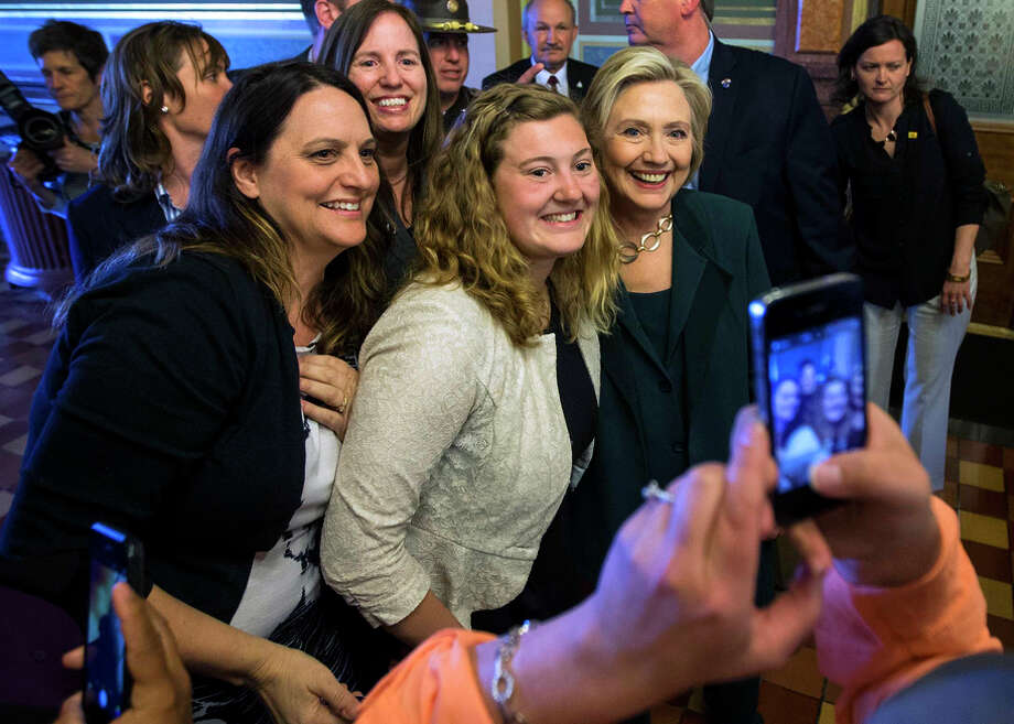Hillary Rodham Clinton poses for a photo after meeting with Democratic lawmakers Wednesday in Des Moines. Photo: DOUG MILLS / New York Times / NYTNS