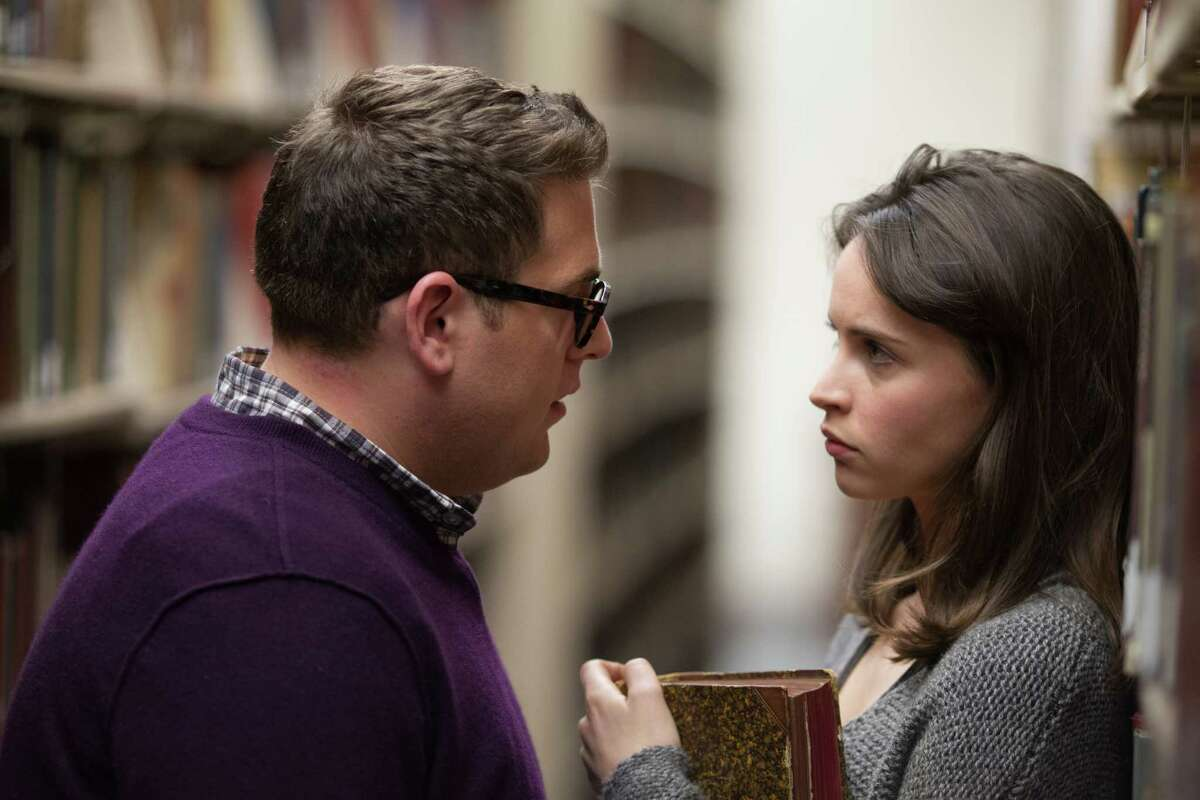 """In this image released by Twentieth Century Fox, Jonah Hill, left, and Felicity Jones appear in a scene from """"True Story."""" (Mary Cybulski/Twentieth Century Fox via AP) ORG XMIT: NYET182"""