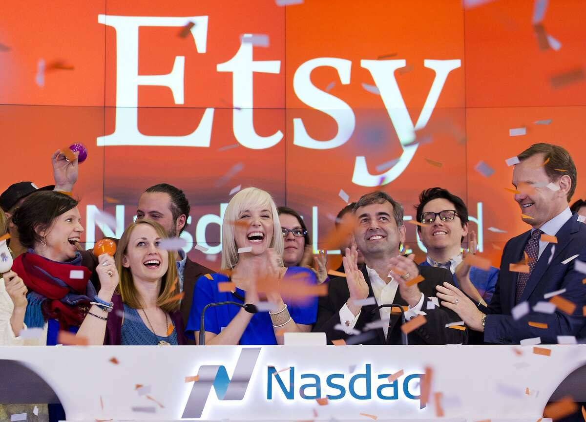 Kristina Salen, center left, Etsy's Chief Financial Officer, stands with Chad Dickerson, center right, Chairman and Chief Executive Officer of Etsy, to celebrate the company's IPO with employees and guests at the Nasdaq MarketSite, Thursday, April 16, 2015, in New York.